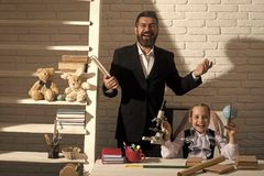 Back to school. Schoolgirl and father with smiling faces hold book, globe Stock Image