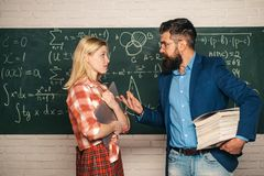Back to school. Science and education concept. Teacher collaborates with colleagues. Teacher. Student and teacher. Sitting at desks in classroom stock images