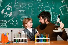 Back to school, science and education for pupil child. Teacher helping young boy with lesson. Cheerful smiling little royalty free stock photos