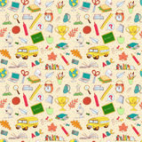 Back to school seamless pattern of kids doodles with bus, books, Royalty Free Stock Photo