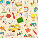 Back to school seamless pattern of kids doodles with bus, books, Stock Images