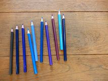 Back to school with the set of the blue color pencils. Set of the blue color pencil on the wood table with ligthing Stock Image