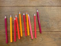 Back to school with the set of red to yellow color pencils. Set of the red to yellow color pencil on the wood table with ligthing Royalty Free Stock Images