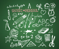 Back to school - set of school doodles. Back to school - set of school doodle illustrations on green blackboard stock illustration