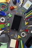 Back to school. Set of school objects for modern education: pens. Scissors, pensils and other multicolored accessories on wooden desk. Top view Royalty Free Stock Photos