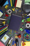 Back to school. Set of school objects for modern education: pens. Scissors, pensils and other multicolored accessories on wooden desk. Top view Royalty Free Stock Images