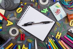 Back to school. Set of school objects for modern education: pens. Scissors, pensils and other multicolored accessories on wooden desk. Top view Stock Image
