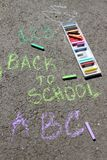 Back to school sigh written with colored chalks on a pavement. Drawing Back to school on an asphalt. and vacation concept. Education concept. School and fun Stock Photography