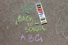 Back to school sigh written with colored chalks on a pavement. Drawing Back to school on an asphalt. and vacation concept. Education concept. School and fun Royalty Free Stock Images
