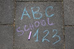 Back to school sigh written with colored chalks on a pavement. Drawing Back to school on an asphalt. School and vacation concept. royalty free stock photos