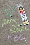 Back to school sigh written with colored chalks on a pavement. Drawing Back to school on an asphalt. and vacation concept. Education concept. School and fun Stock Photos