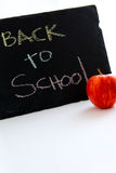 Back to school sign and an apple for the teacher Royalty Free Stock Image