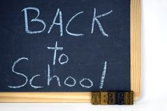 Back to school sign on black chalkboard Stock Photography