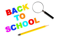 Back to school sign with magnifier and pencil Royalty Free Stock Photography