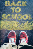Back to school sign. Urban teenage standing above the signe back to school Royalty Free Stock Photography