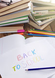 Back to school sign  on the white paper on the wooden table Royalty Free Stock Images