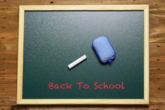 Back to school. Signage back to school on green chalkboard Stock Photo
