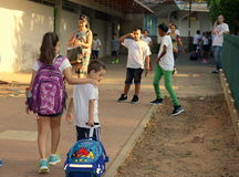 Back to school: sister and brother on their first day. Back to school: an 11-year-old girl accompanying her first-grader 6-year-old brother on the first day of Stock Image