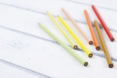 Back to School. Some colored pencils on a white wooden table. Vintage Style Royalty Free Stock Images