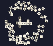 Back to school spelled out in plastic letter tiles Royalty Free Stock Images