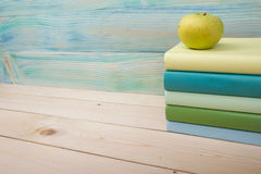 Back to school. Stack of colorful books on wooden Royalty Free Stock Image