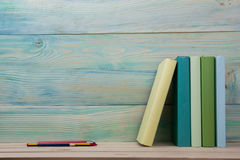 Back to school. Stack of colorful books on wooden table. Copy space Stock Photo