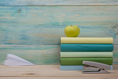 Back to school. Stack of colorful books on wooden table. Copy space Royalty Free Stock Photo