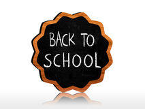 Back to school on star-like blackboard Royalty Free Stock Photo