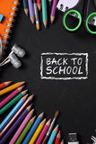 Back To School, stationeries on blackboard. Back to school. Colorful school supplies over black board background design Royalty Free Stock Image