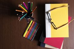 Back to school. School Stationery  are on the table infront of a black board Stock Image