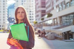 Back to school student teenager girl holding books and note books wearing backpack. Outdoor portrait of young teenager brunette gi stock image
