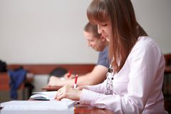 Back to school. Students in classroom. Royalty Free Stock Photo