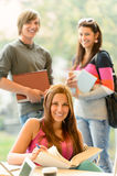 Back to school students studying in library. Smiling learning education Royalty Free Stock Image