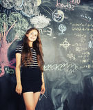 Back to school after summer vacations, cute teen girl in classroom Royalty Free Stock Photography