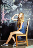 Back to school after summer vacations, cute teen real girl in classroom Royalty Free Stock Photo