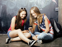 Back to school after summer vacations, two teen Stock Photography