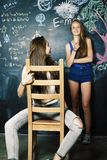 Back to school after summer vacations, two teen real girls in cl stock photos