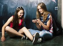 Back to school after summer vacations, two teen real girls in cl stock images