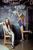 Back to school after summer vacations, two teen Stock Image
