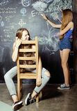 Back to school after summer vacations, two teen Stock Photos
