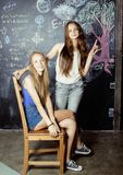 Back to school after summer vacations, two teen Royalty Free Stock Photo