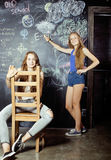 Back to school after summer vacations, two teen Royalty Free Stock Photography