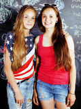Back to school after summer vacations, two teen real girls in classroom with blackboard painted together, lifestyle Royalty Free Stock Photography