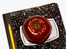 Back to school supplies. School supplies and apple for the teacher Stock Images