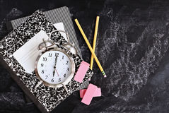 Back to School Supplies and Alarm Clock royalty free stock photography