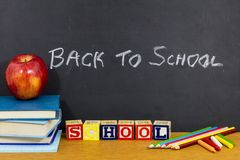 Back to school supplies apple books abc blocks spelling stock images