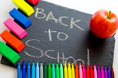 Back to school supplies and an apple for the teacher Stock Photo