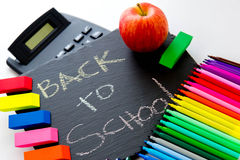 Back to school supplies and an apple for the teacher Royalty Free Stock Photos
