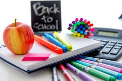 Back to school supplies and an apple for the teacher Stock Image