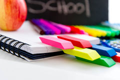 Back to school supplies and an apple for the teacher Royalty Free Stock Photography
